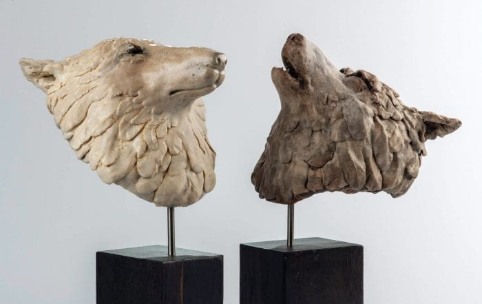 Bo & Lila stoneware wolves on oak stands.